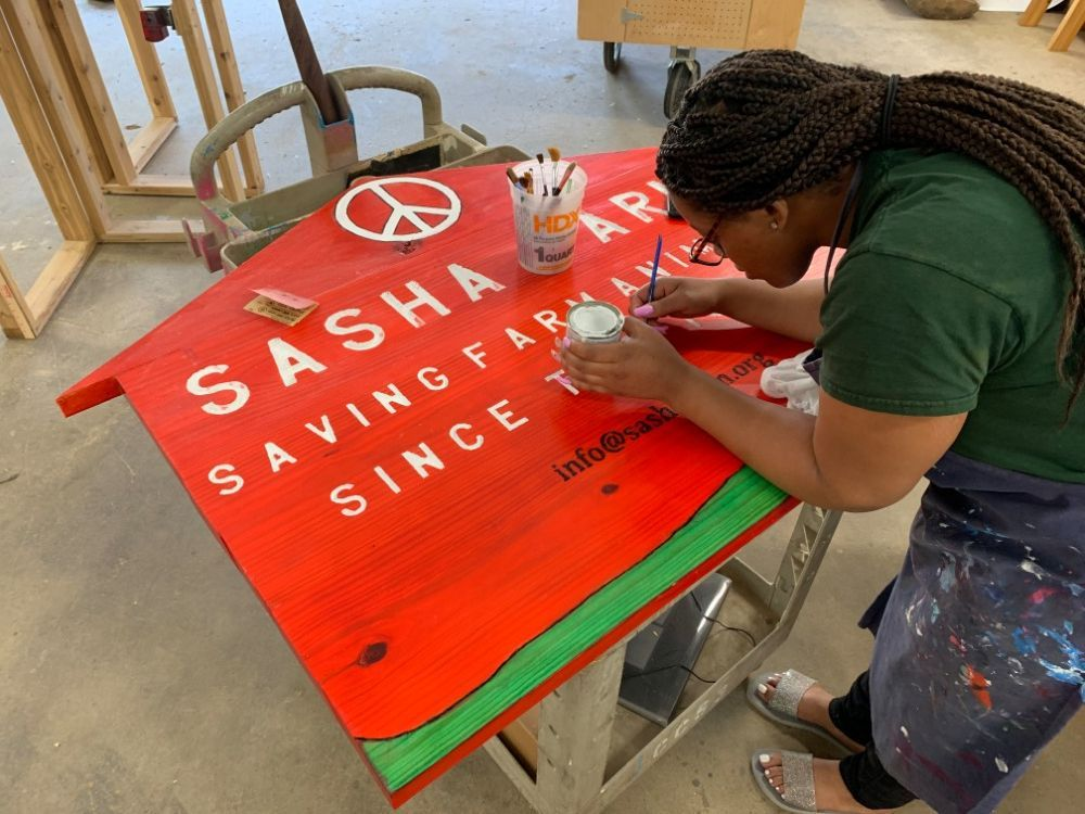 Brightmoor Makers student painting a sign